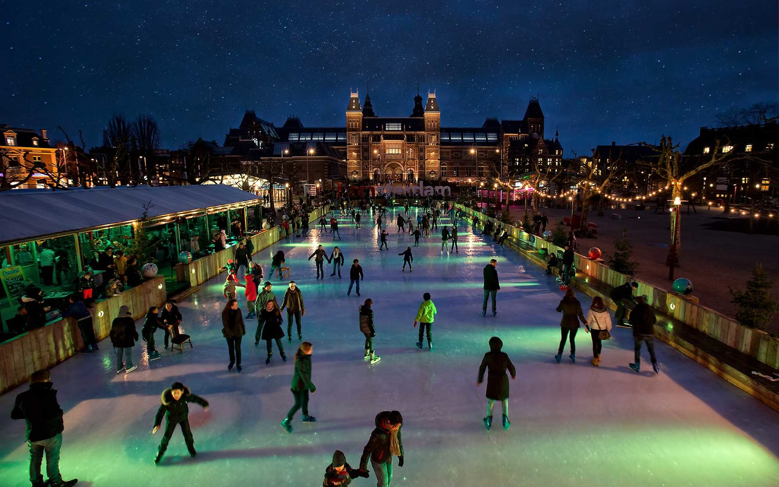 [UNVERIFIED CONTENT] Crowded ice skating rink with starry sky at night, Museumplein Amsterdam. In front of the Rijksmuseum.