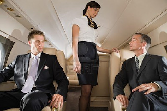 10126491-businessmen-and-stewardess-on-jet