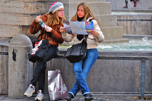 These two young women were sitting at the base of obelisk in Rome's Piazza del Poppolo, consulting what appears to be a tourist map of some kind. Now they're both looking at the map, looking somewhat puzzled and frustrated... *********************** These photos were taken during a week in Rome, at the beginning of December 2008. I was participating in a computer conference, but had some free time at the beginning and end of the trip; unfortunately, the weather was not very cooperative, and my photography efforts were sometimes interrupted by rain...